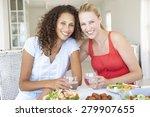 two young women enjoying meal...   Shutterstock . vector #279907655