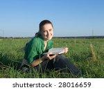girl reading at green grass...   Shutterstock . vector #28016659