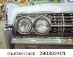 Closeup Of The Headlights Of A...