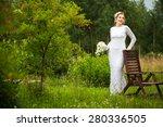 beautiful young bride standing... | Shutterstock . vector #280336505