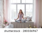girl in pajama meditating on... | Shutterstock . vector #280336967