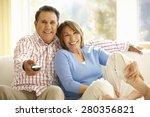 Senior Hispanic Couple Watchin...