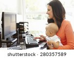 Small photo of Hispanic mother with baby working in home office