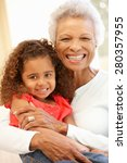 Small photo of Senior African American woman and granddaughter