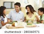 Asian Family Sharing Meal At...