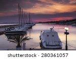 Yacht On The Marina At Sunset