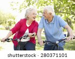 senior couple riding bikes | Shutterstock . vector #280371101