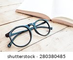 black eye glasses with a book ... | Shutterstock . vector #280380485