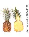 halved fresh pineapple on the... | Shutterstock . vector #28061122
