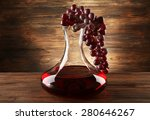Glass Carafe Of Wine On Wooden...