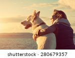 Stock photo young attractive girl with her pet dog at a beach colorised image 280679357