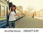 Girl With A Guitar At Train...