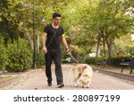 Stock photo young man with dog relaxed 280897199