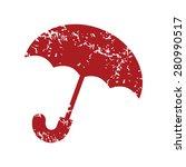 red grunge umbrella logo on a...