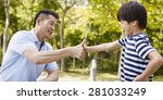 asian father and elementary age ... | Shutterstock . vector #281033249