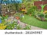 Lush landscaped backyard flower garden with flowerbed - stock photo