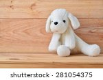 Plush White Dog With A Wooden...