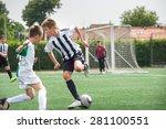 boys kicking football on the... | Shutterstock . vector #281100551