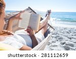 brunette reading a book while... | Shutterstock . vector #281112659