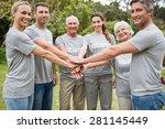 happy volunteer family putting...   Shutterstock . vector #281145449
