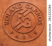 Small photo of PARIS, FRANCE- MAY 23, 2015: Roland Garros logo done in clay at Le Stade Roland Garros in Paris, France