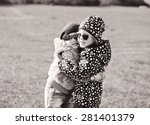 two little girls are hugging in ... | Shutterstock . vector #281401379