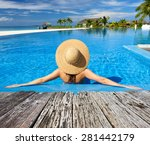 Woman In Hat Relaxing At The...