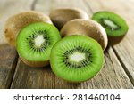 Juicy Kiwi Fruit On Wooden...