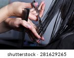 Small photo of The master the hairdresser does a hairdress in salon