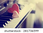Red Wooden Hearts On A Piano...