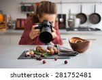 a woman food photographer in... | Shutterstock . vector #281752481