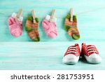 Stock photo colorful toddler shoes on wooden background 281753951