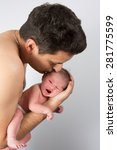 Father Cuddling His New Born...