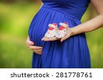 Pregnant Woman Belly Holding...