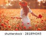 Beautiful Girl In A Poppy Fiel...