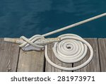 Coiled White Cloth Boat Rope...
