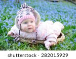 infant baby in snowdrops | Shutterstock . vector #282015929