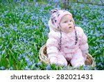 little girl in flowers field | Shutterstock . vector #282021431