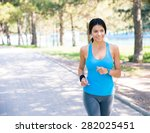 smiling sporty woman running... | Shutterstock . vector #282025451