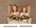 Two Little Bridesmaid Sitting...