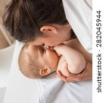 mother playing with her baby ... | Shutterstock . vector #282045944