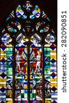 Small photo of mosaic vitrage window Adam and Eve icon. Interior of church Bremen Cathedral, Germany