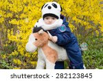 boy rocking toy horse | Shutterstock . vector #282123845
