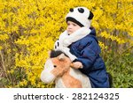 boy sit on horseback on yellow... | Shutterstock . vector #282124325