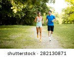 young couple running | Shutterstock . vector #282130871