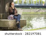 young woman sitting with laptop ... | Shutterstock . vector #282197081