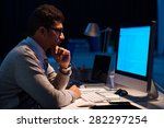 young man working on computer... | Shutterstock . vector #282297254