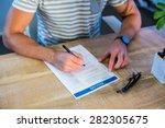 man writing curriculum vitae at ... | Shutterstock . vector #282305675