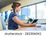 smiling brunette holding tablet ... | Shutterstock . vector #282306041