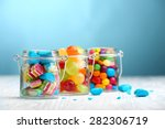colorful candies in jars on... | Shutterstock . vector #282306719